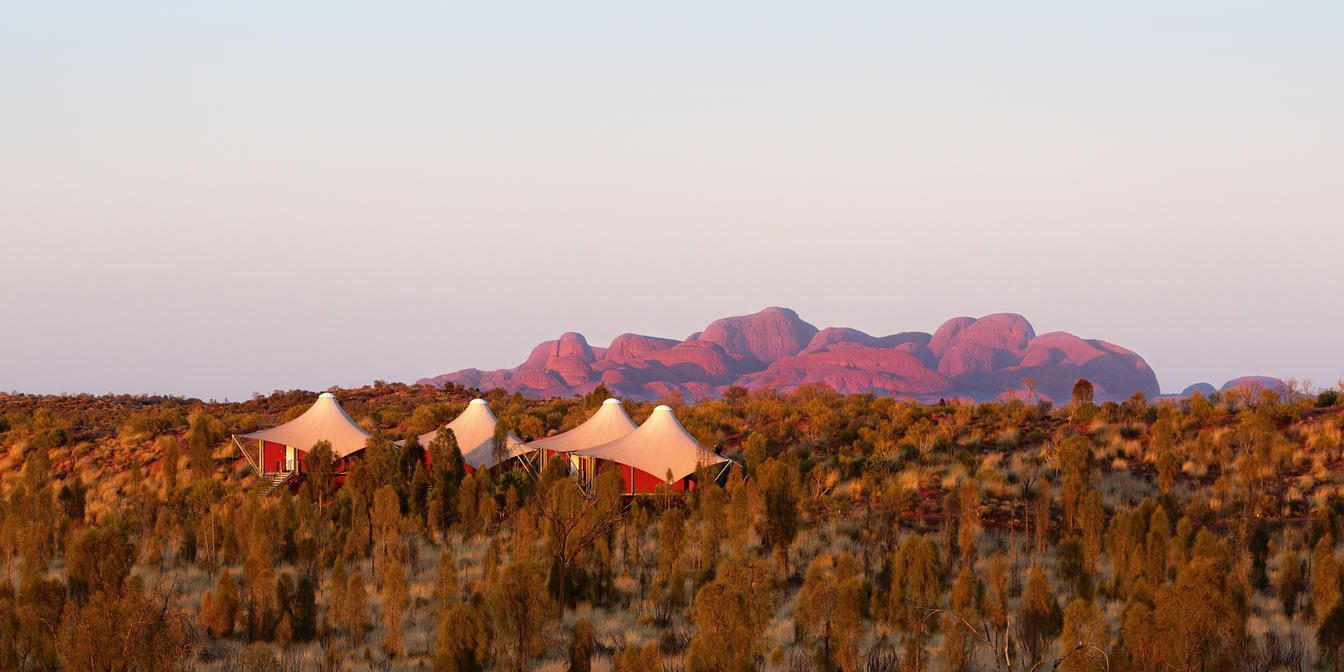 Tent roofs of Longitude 131 with the red rocky Kata Tjuta in the background