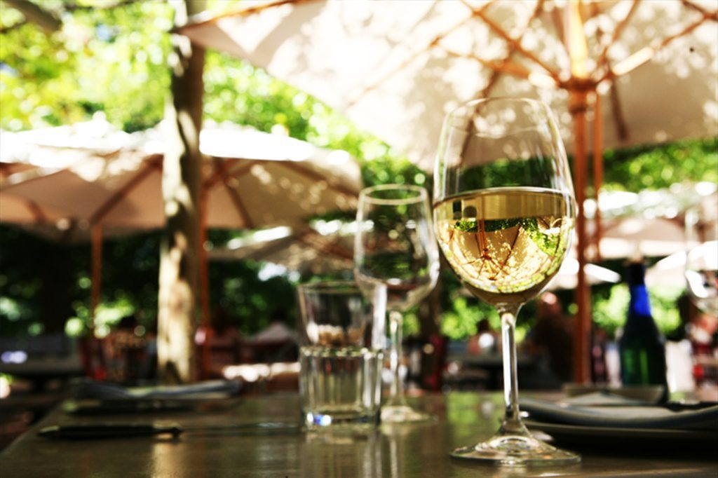 white wine glasses at a wine tasting on a sunny day at LQF in the cape winelands