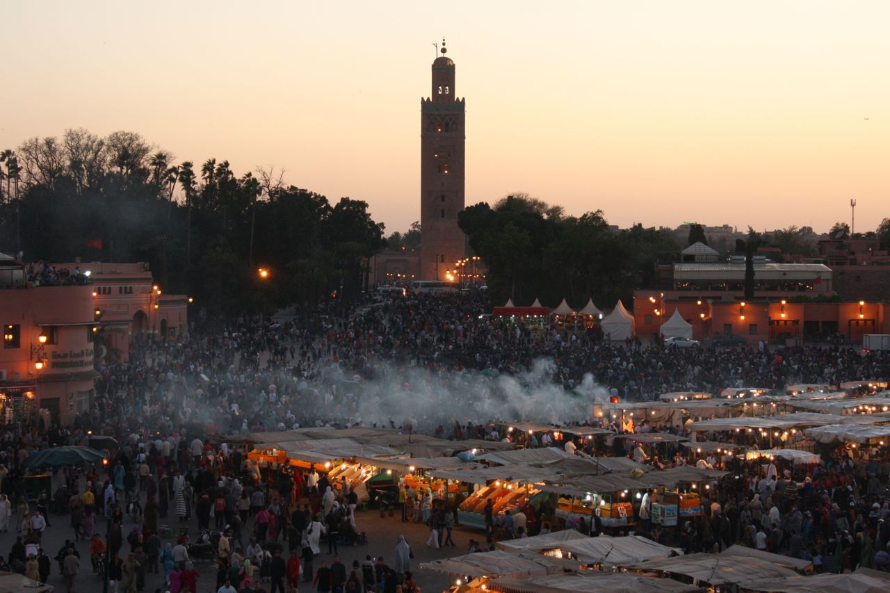 Medina of Marrakech at sunset with street vendors