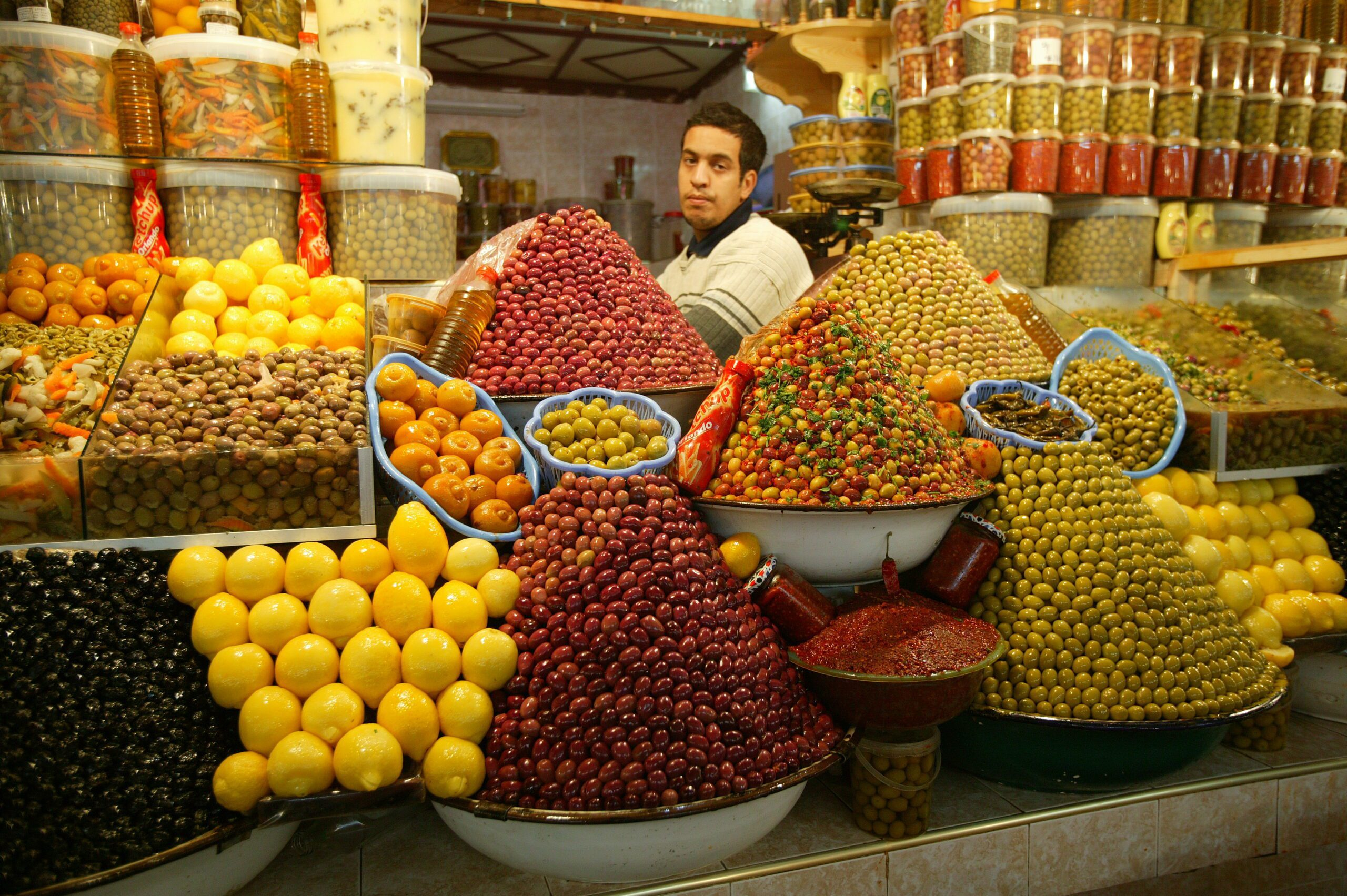 Visit Morocco to see olives piled high at a souk in Marrakech
