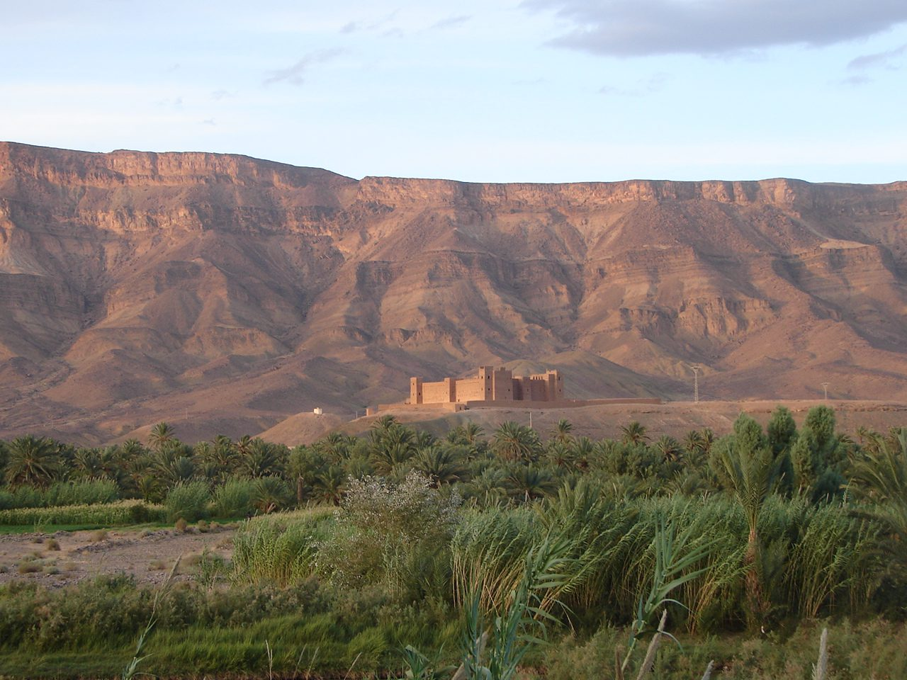 Ouarzazate in the distance, surrounded by green desert and mountains
