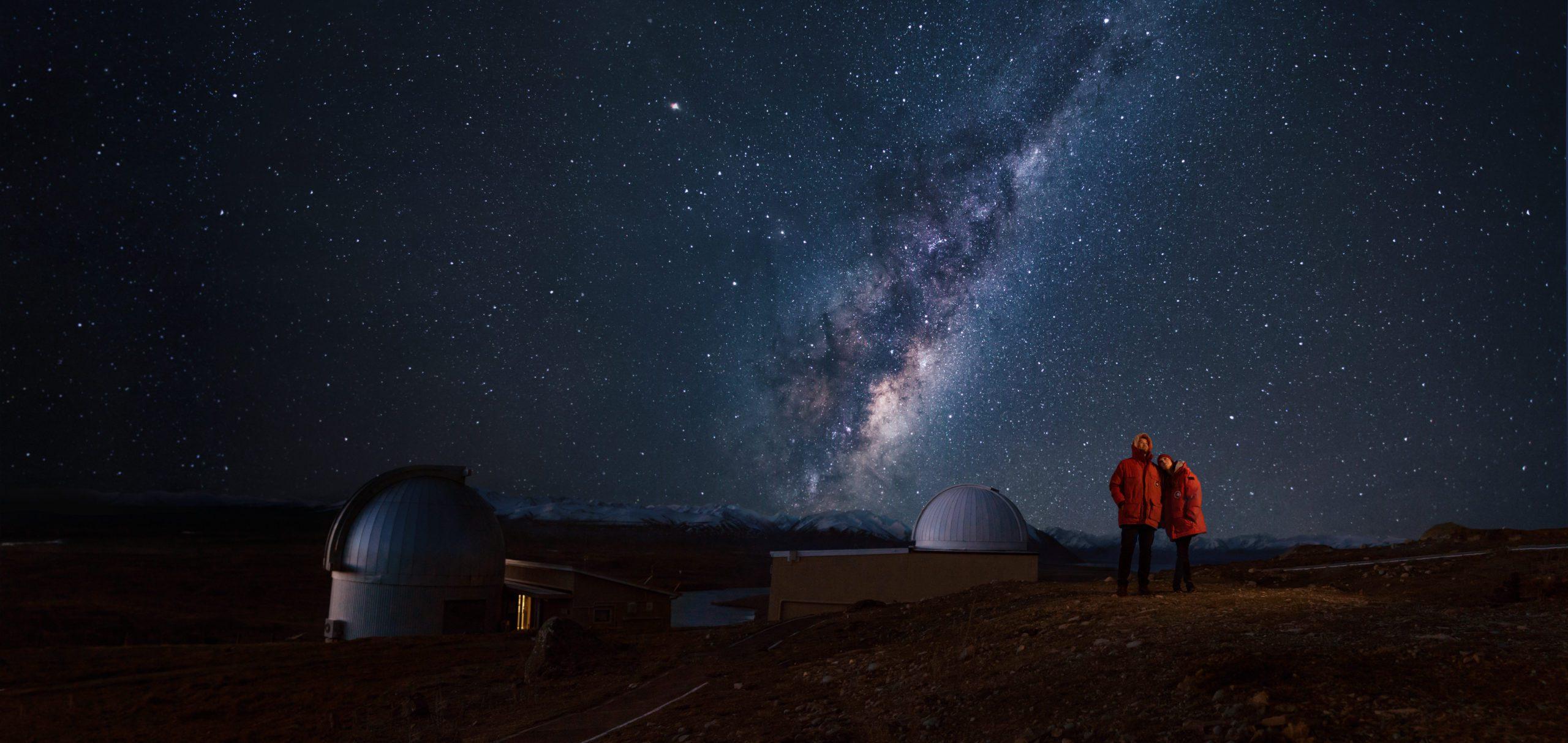 International Dark Sky Reserve in Tekapo - people outside the observatory on a starry night.