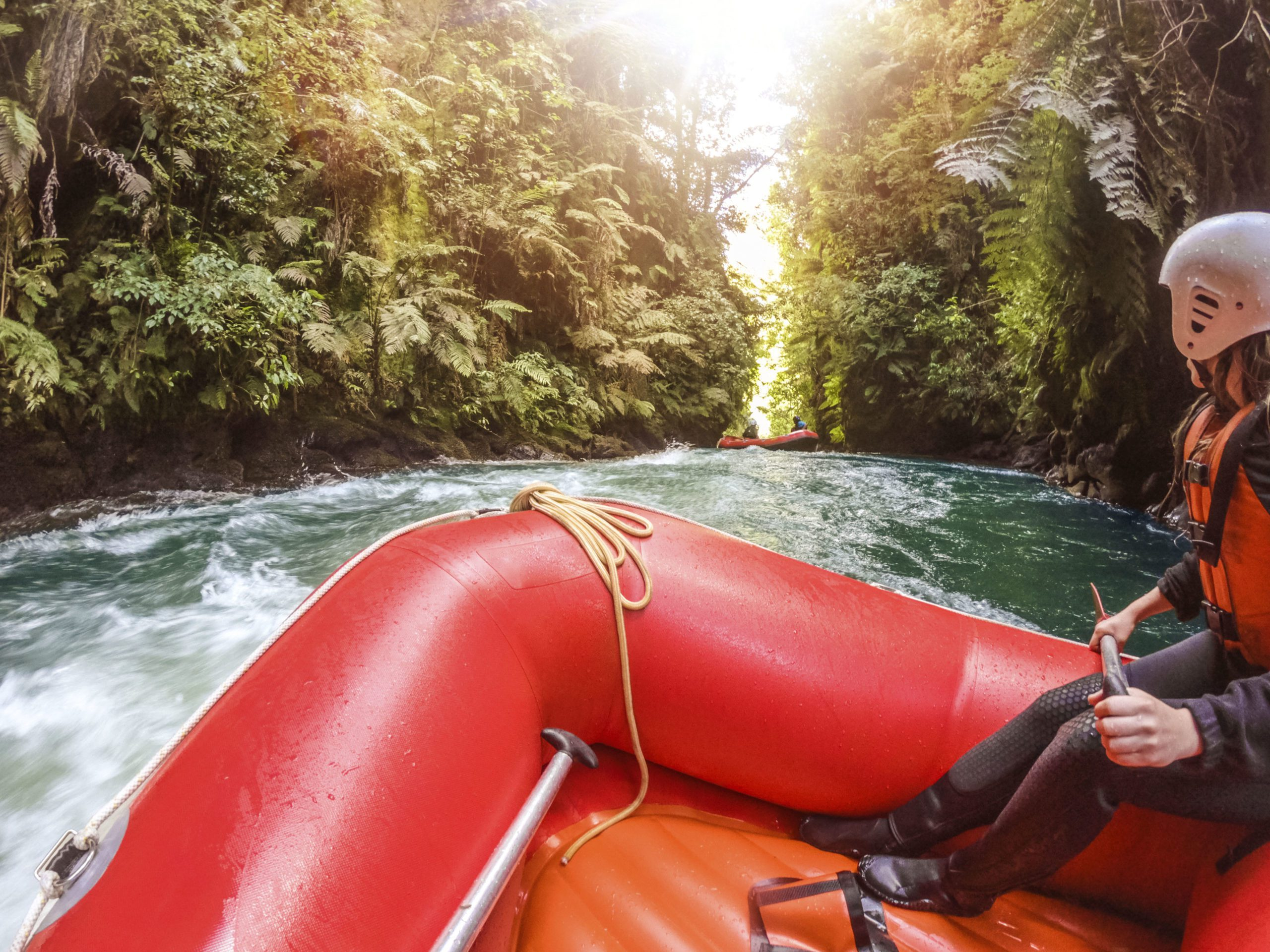 Woman on the front of a whitewater raft on the Kaituna River in Rotorua