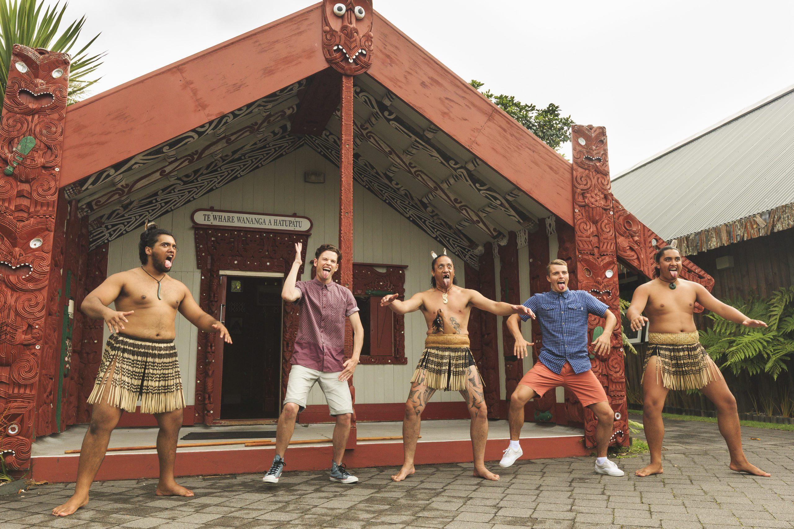 Tourists doing the Haka with some Maori guys at Te Puia