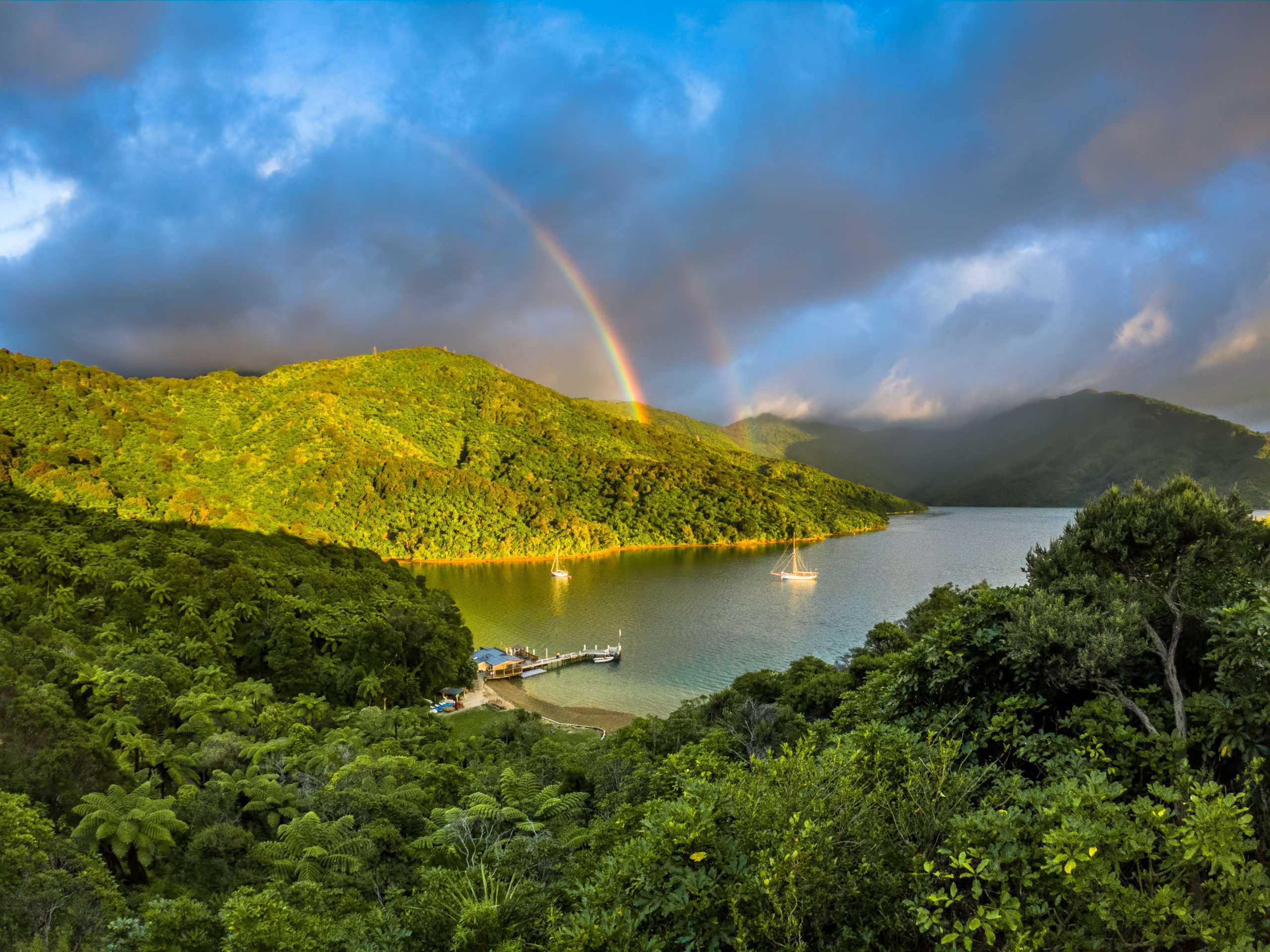 A rainbow over the mountains and sea in Marlborough Sounds.
