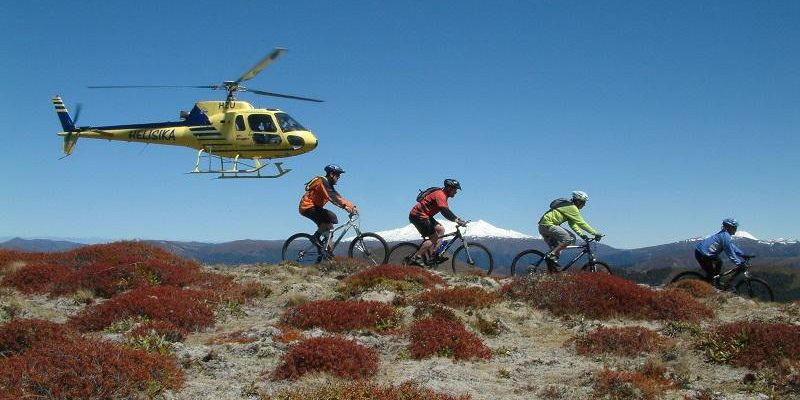 New Zealand bicycle travel with helicopter in background