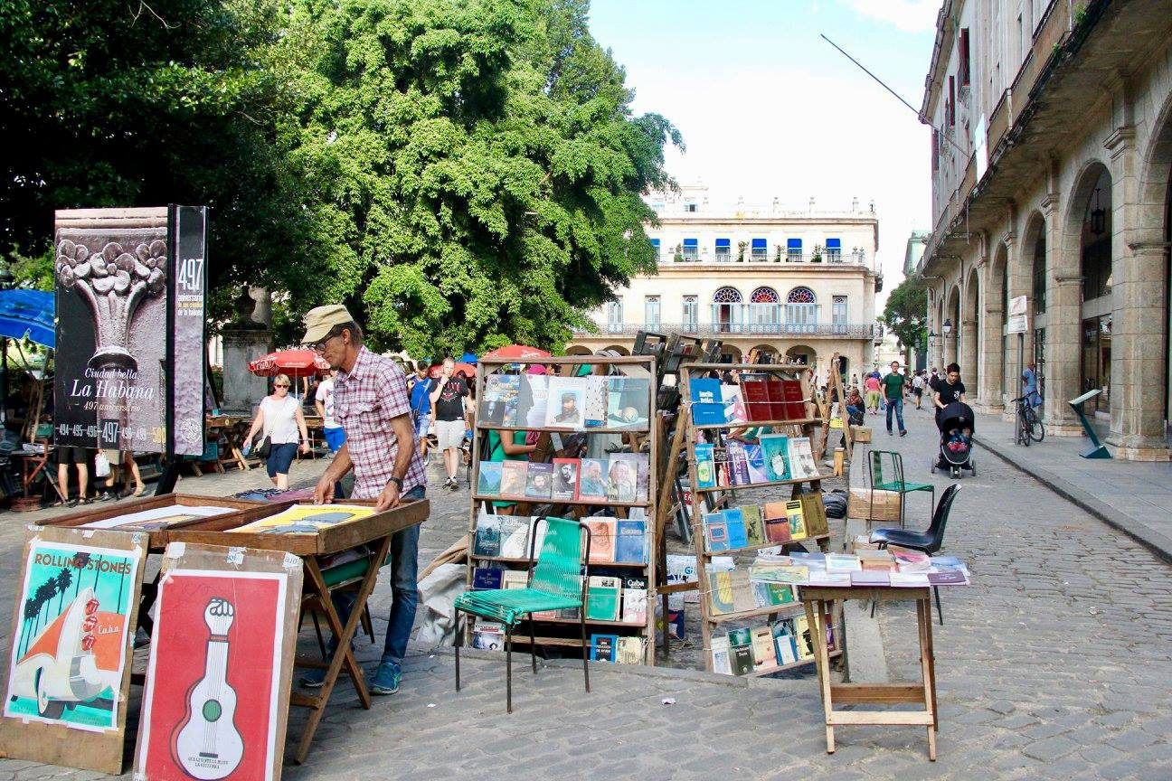 Art vendors set up in a Havana square