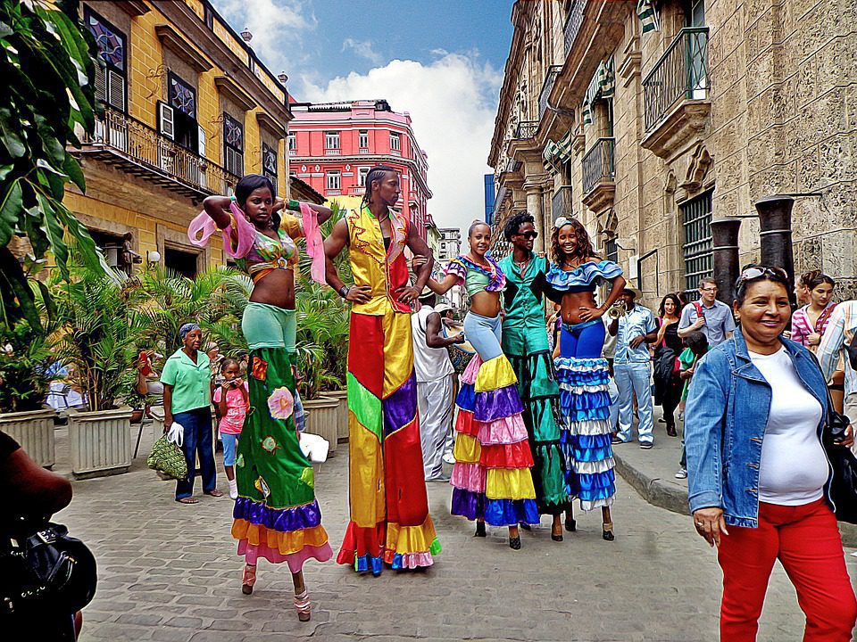 Woman on stilts as entertainers in Havana on Cuba holiday