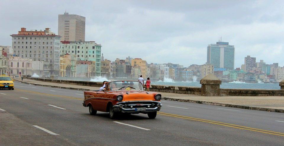 Retro autombile driving along the malecon