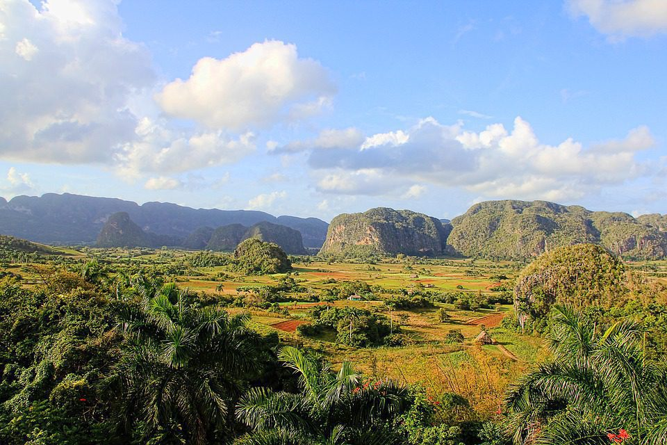 Stunning mountains jutting high above farmland in Vinales on safari in Cuba