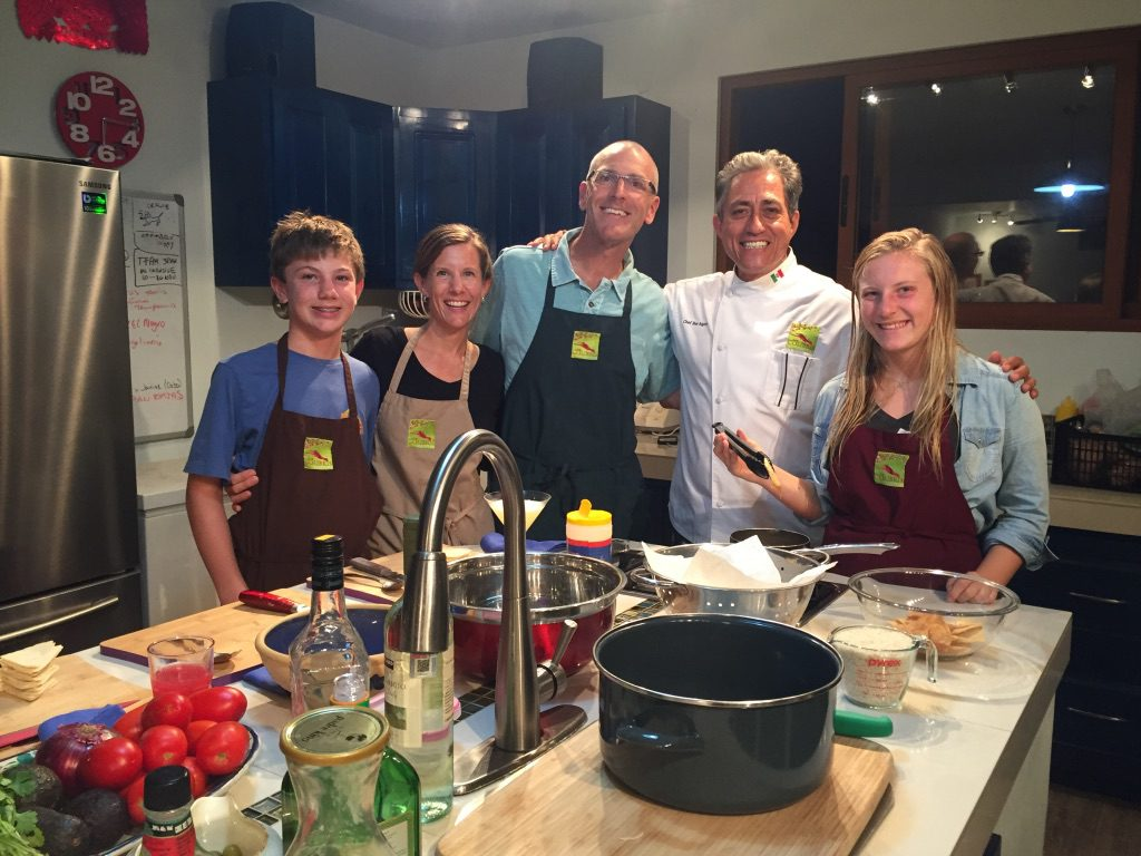 family taking a cooking class on safari in Mexico