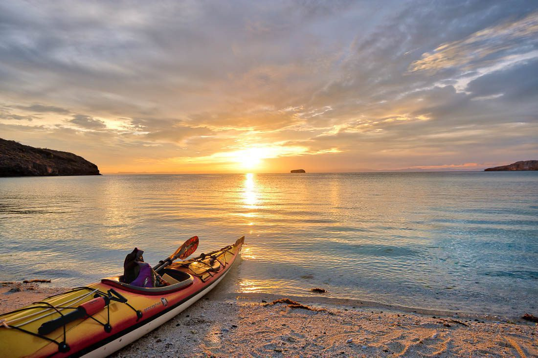 kayaking safari on sand pointed at sunset on Mexico holiday