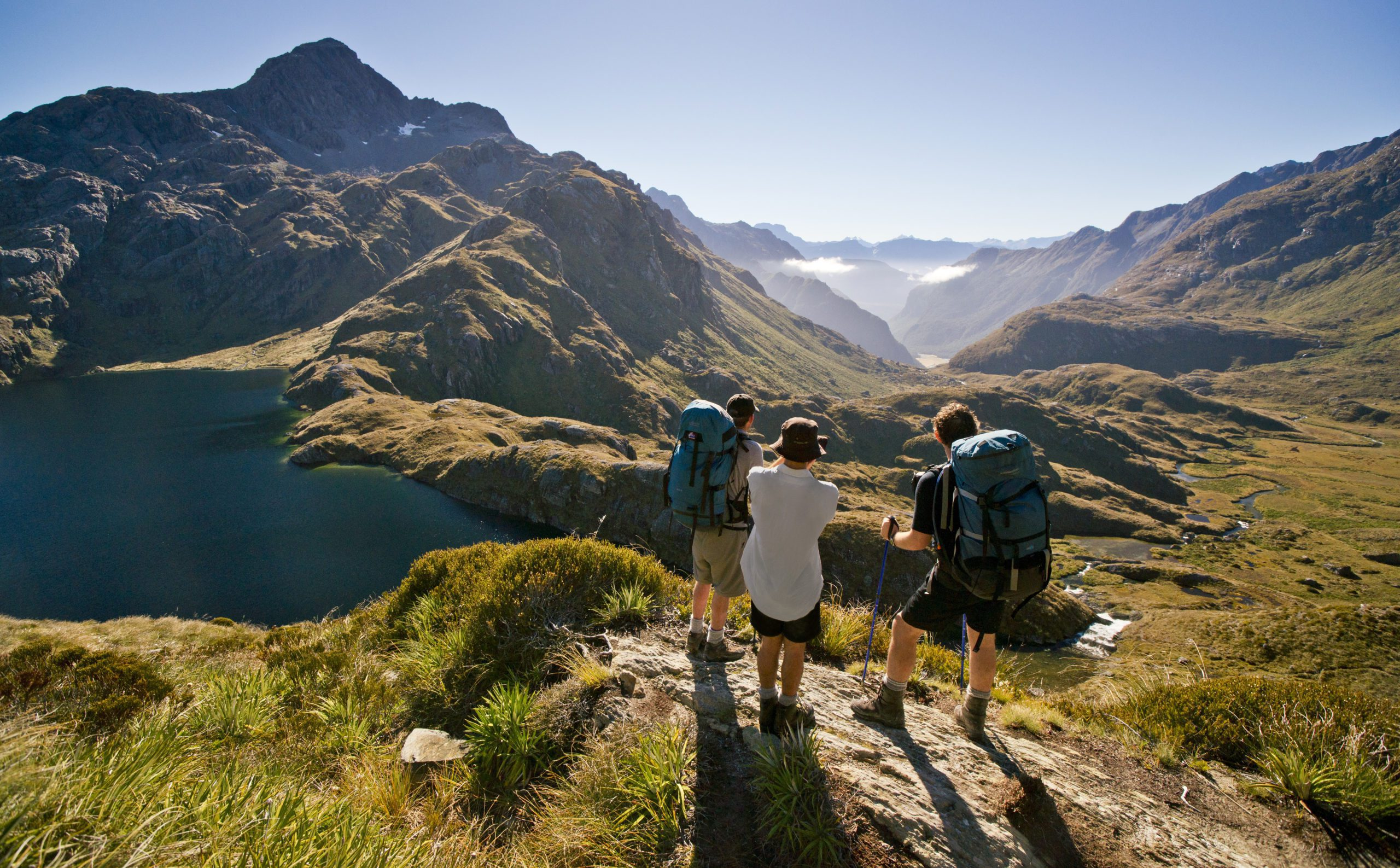 Hikers stop to enjoy the mountain views on the Routeburn Track.