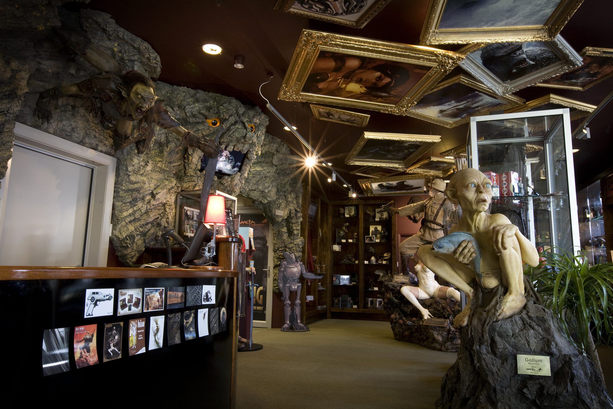Inside the whacky Weta Cave Museum with picture frames on the ceiling.