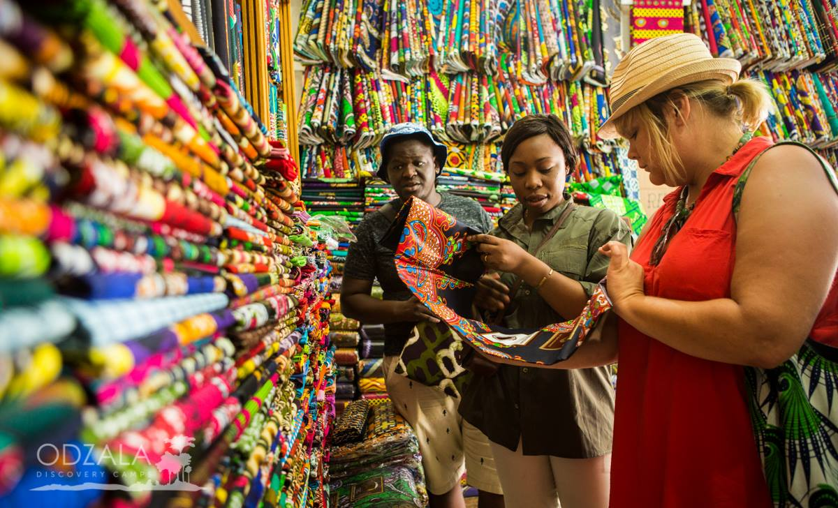 three women at a fabric store in brazzaville