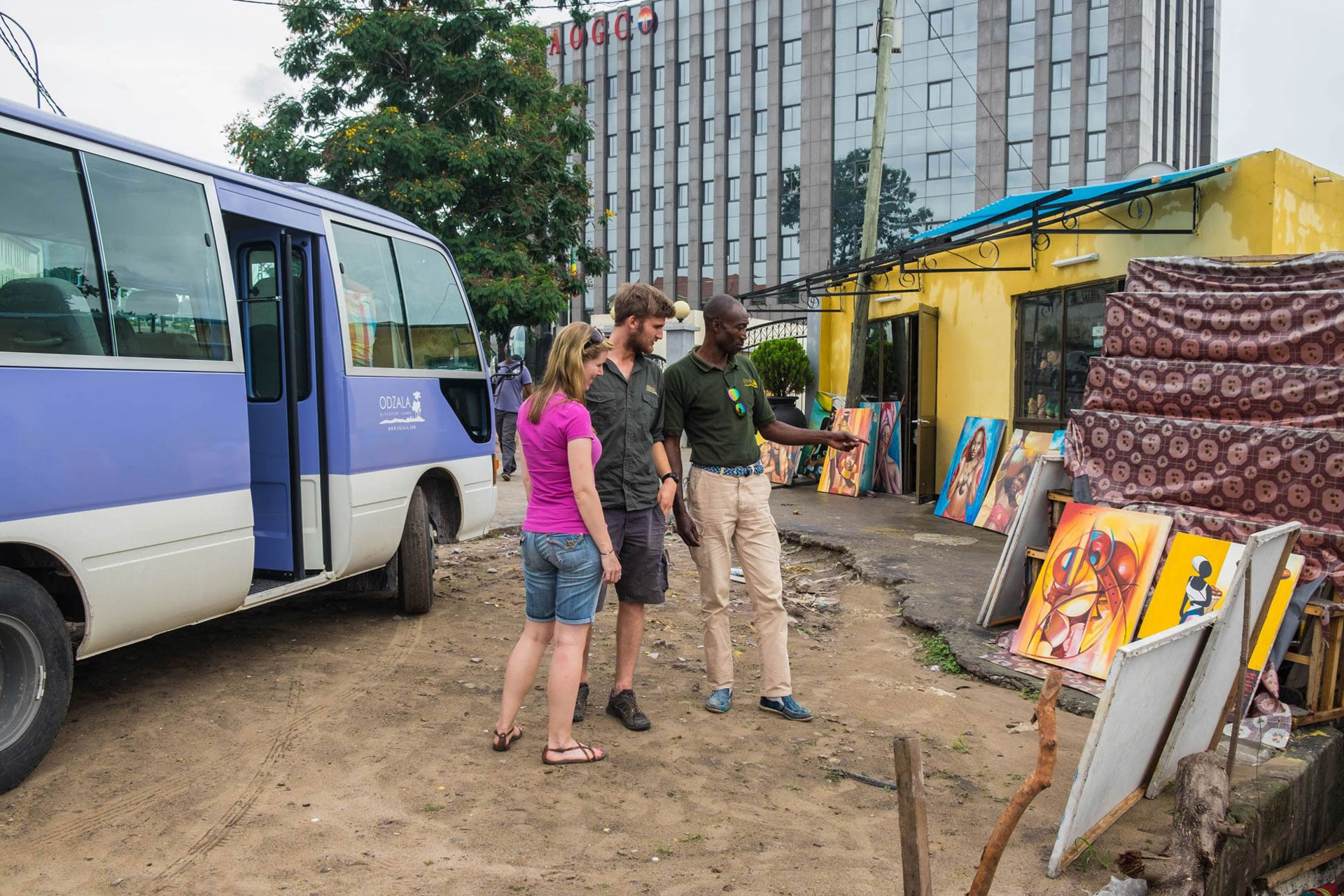 tourists shopping at art market in Brazzaville