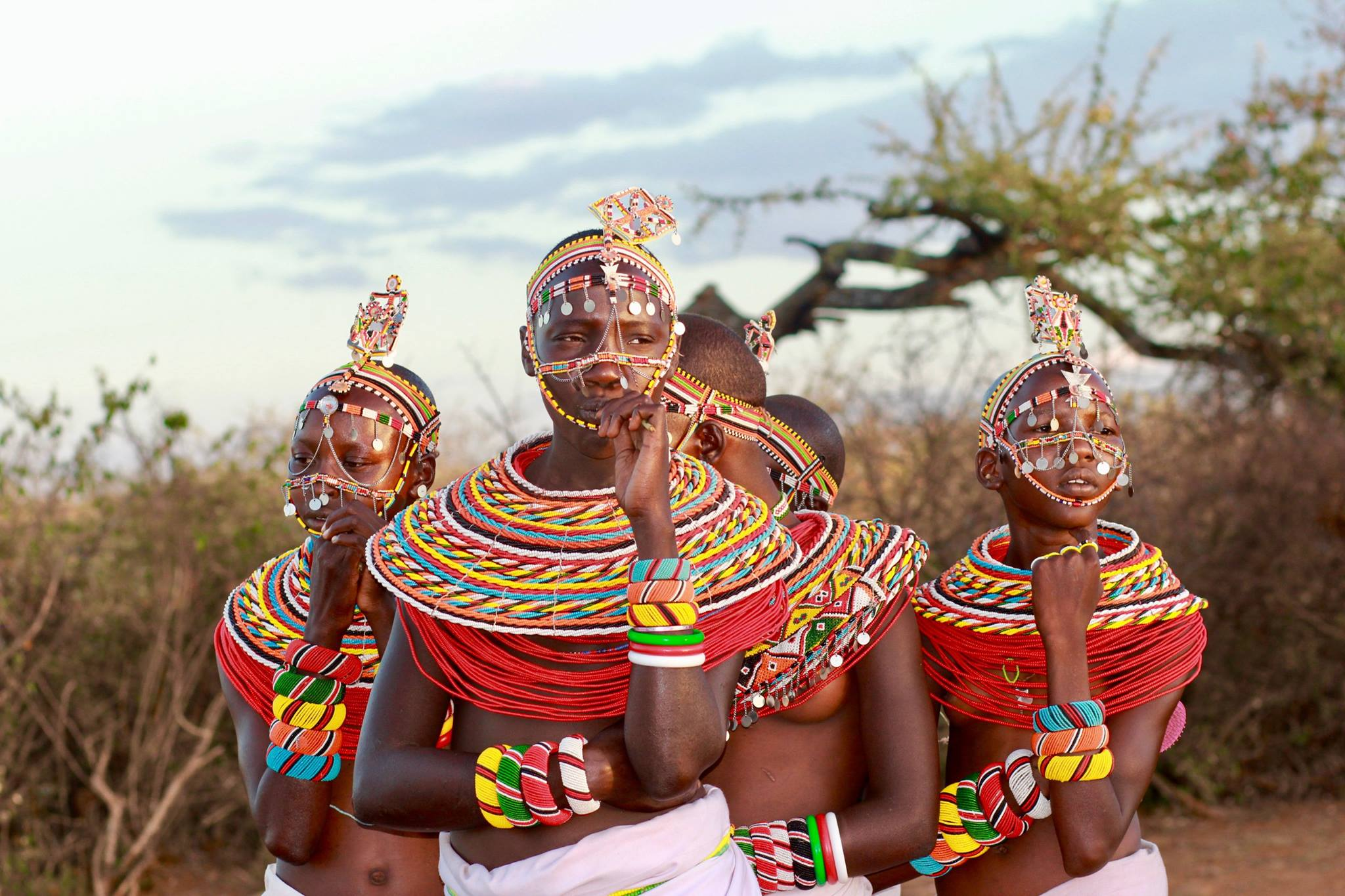 four samburu warriors in extravagantly beaded collars and headdress