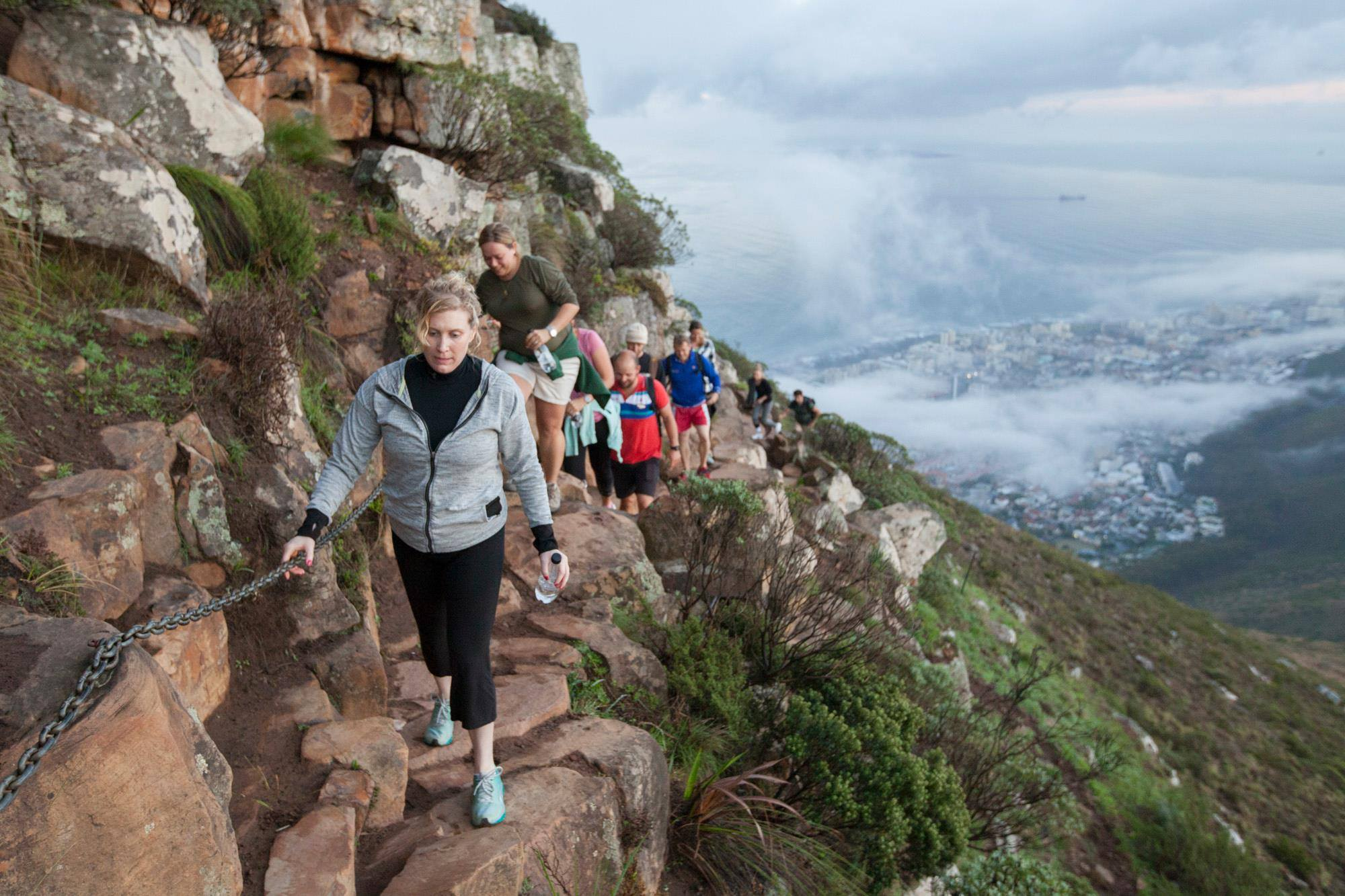 Hikers along one of Cape Town's mountain steep paths while hiking and climbing on safari