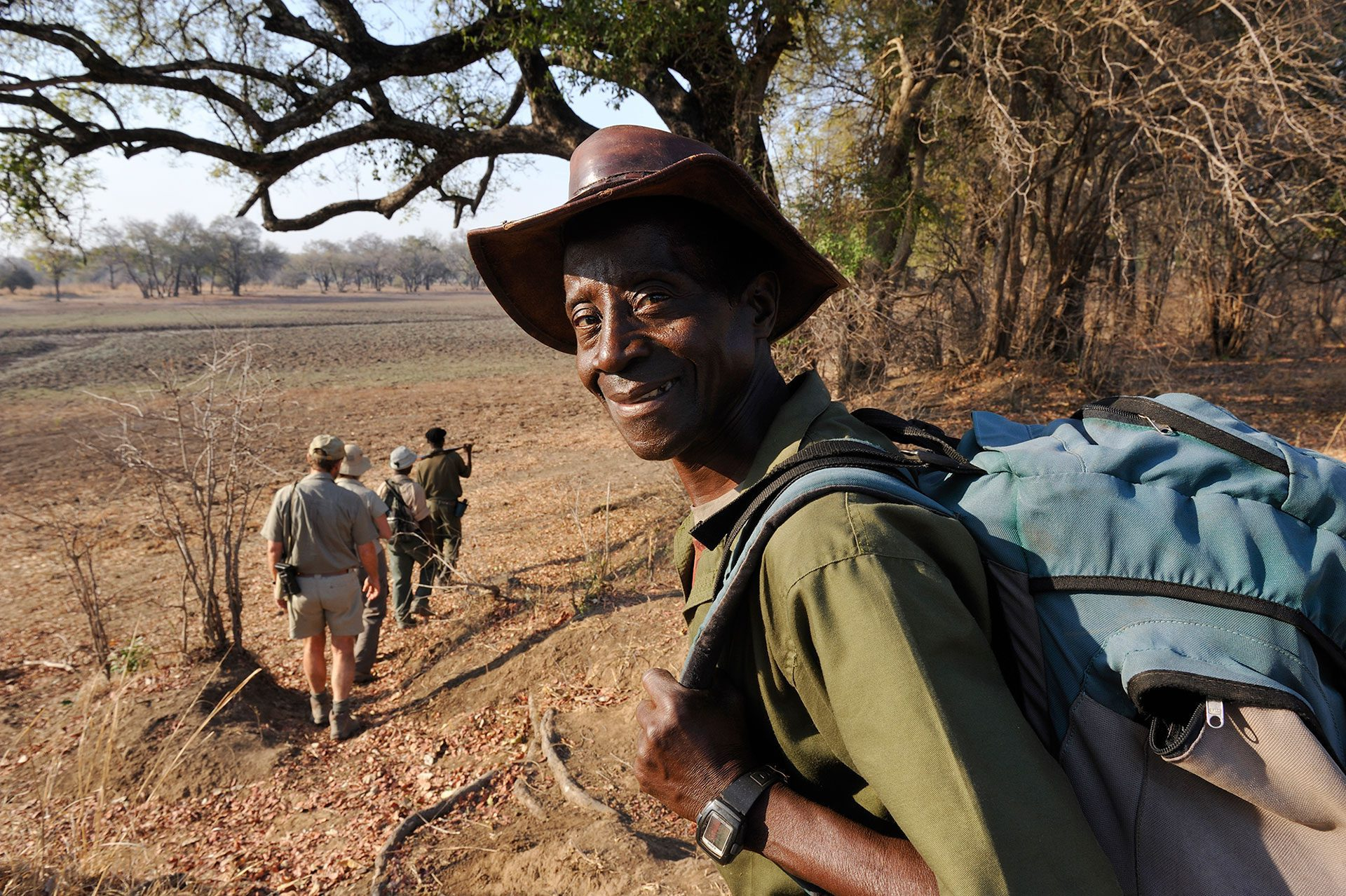 guests walking with guide on our Zambia on foot safari