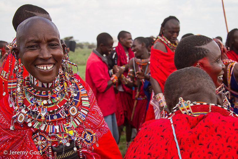 group of maasai smiling at maasai olympics seen on our cultural safari