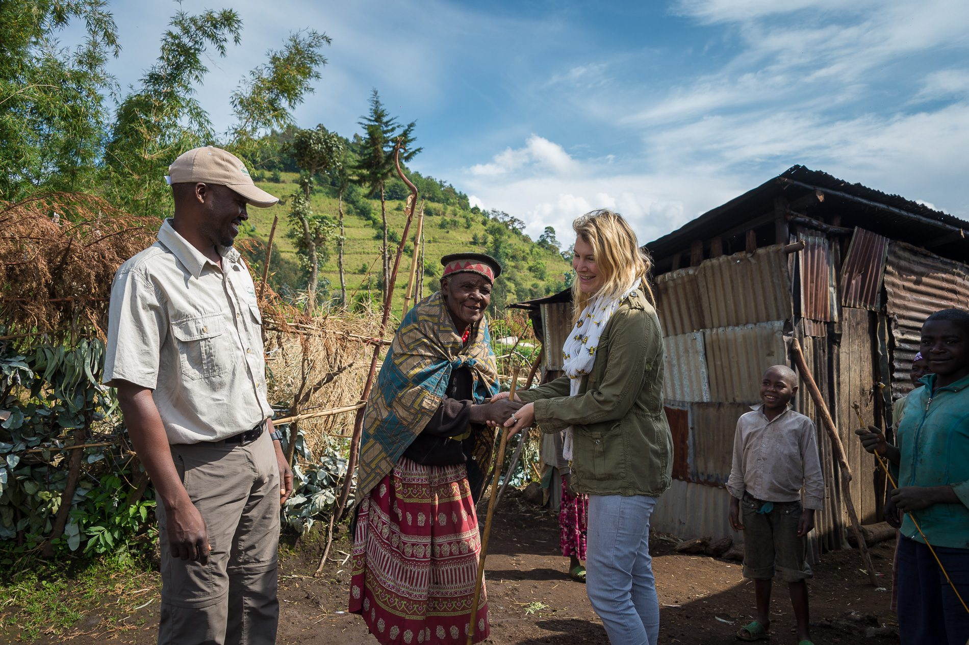 tourist visits Rwandan village with guide