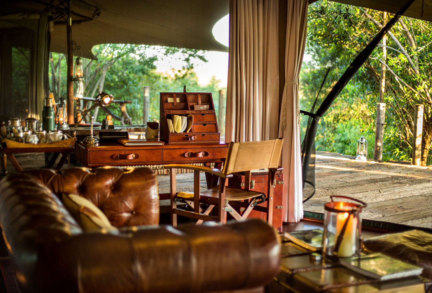 couch and vintage desk inside a tent at Mara Plains