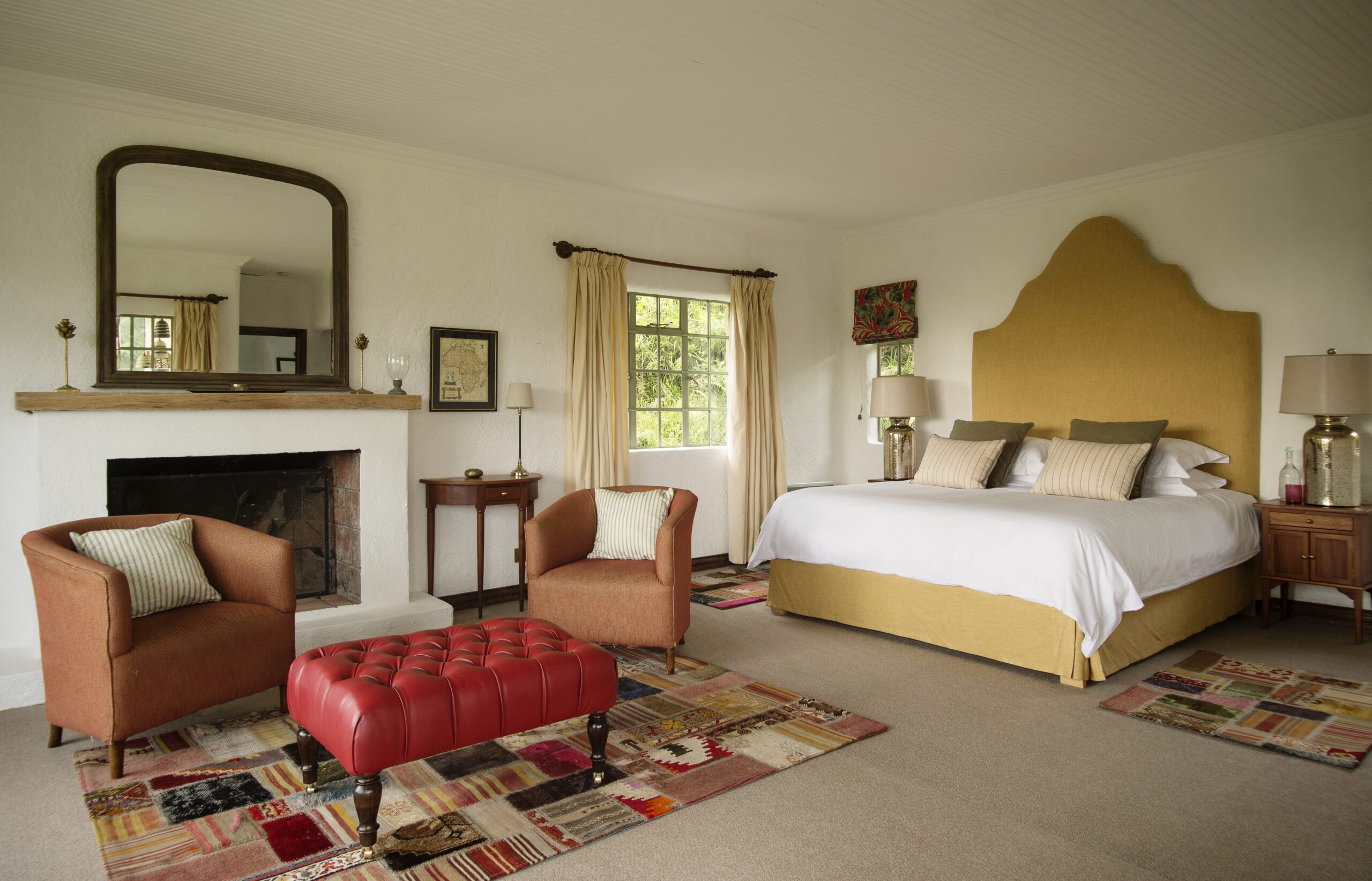 bedroom with fireplace at sabyinyo silverback lodge