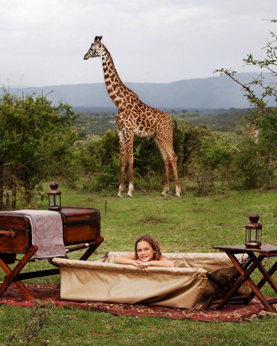 bush bath at cottar's camp with giraffe in background