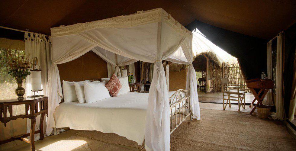 tented bed in Masai Mara on Africa safari
