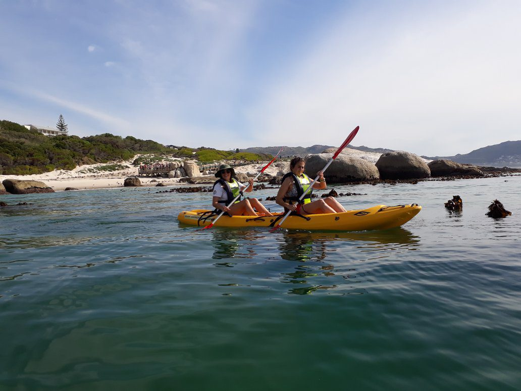 two kayakers in a bay with boulders in the background on one of our premier safari destinations