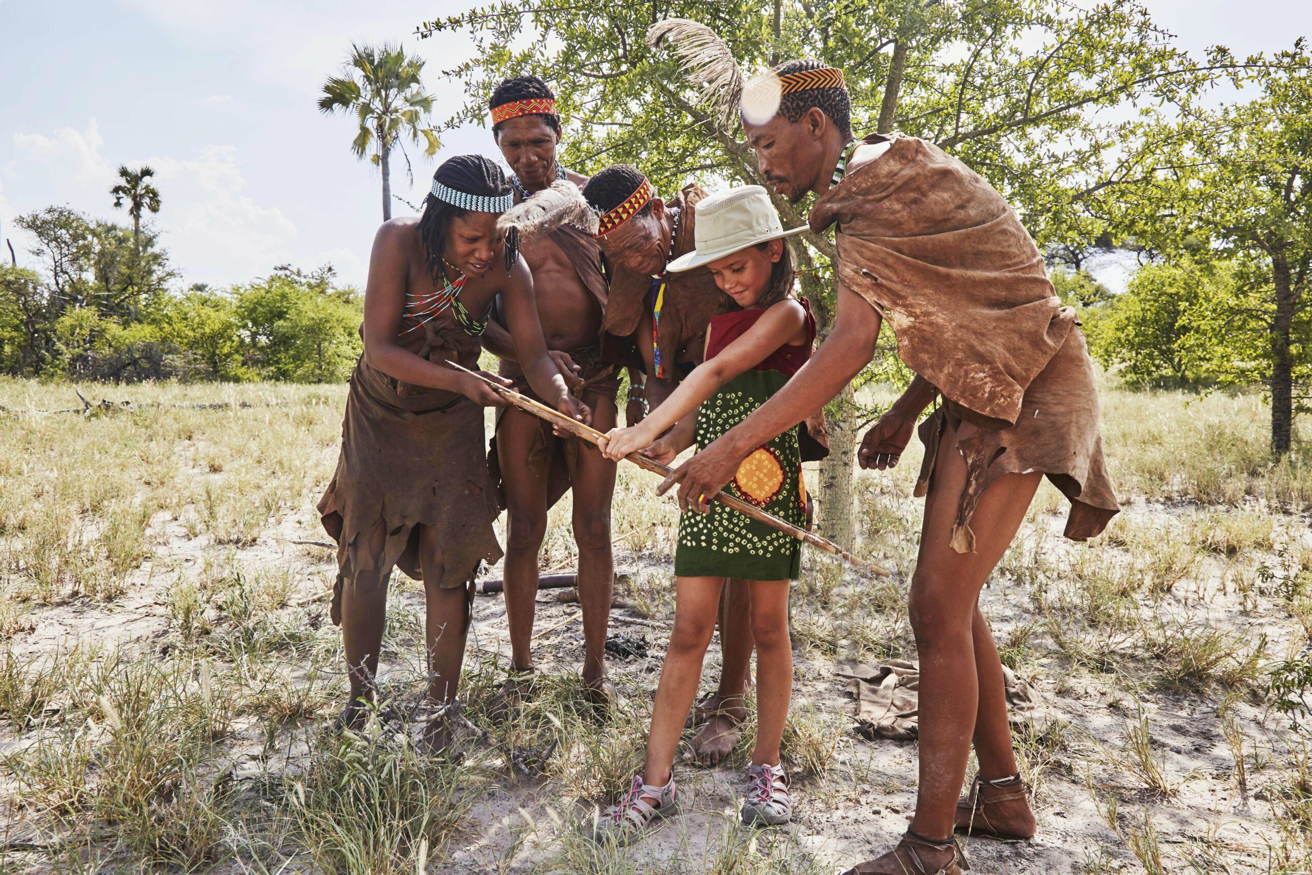 child with San bushmen in the Kalahari
