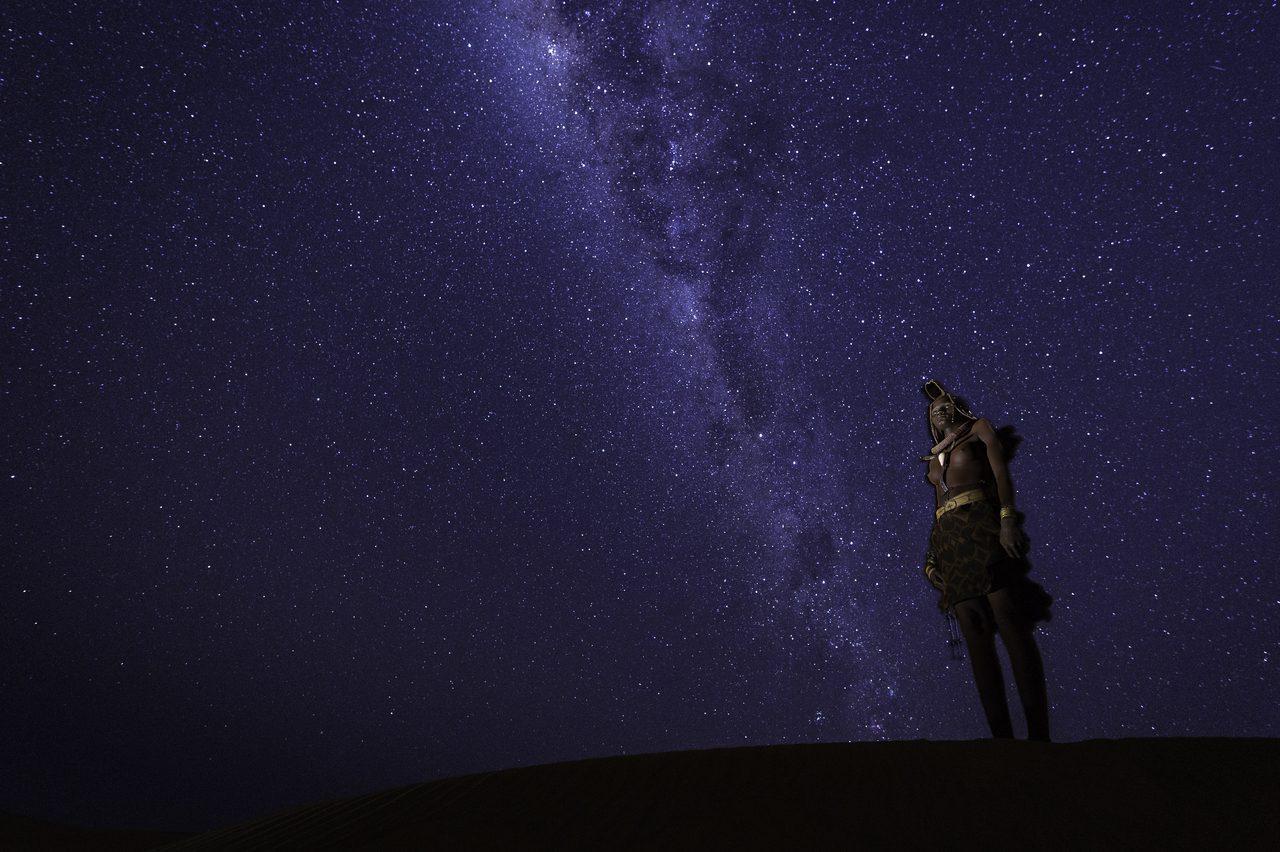Tribal woman beneath the starry sky in Kunene