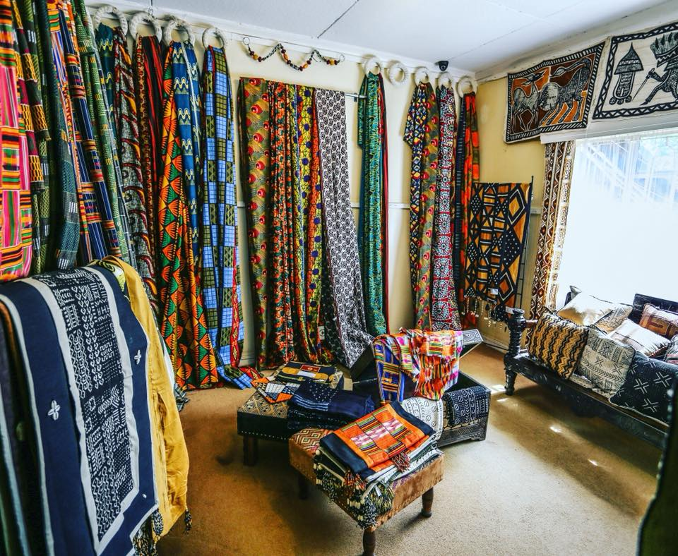 room with assorted cloth hanging on the walls