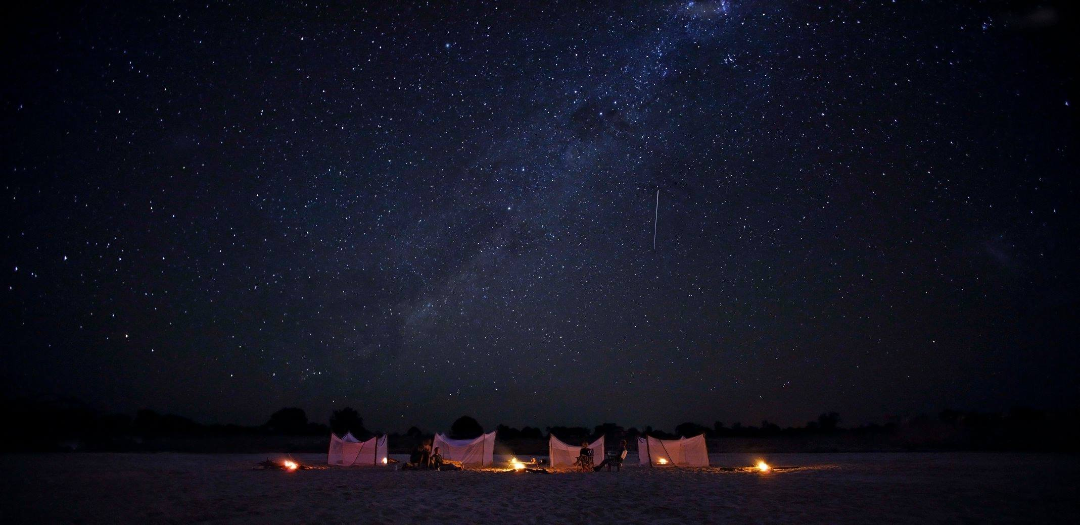 sleep out/fly camp with 4 tents under the stars at luwi plains