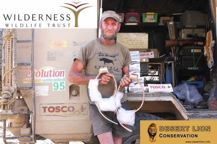 Desert lion conservation leader phil stander standing by a truck holding collars