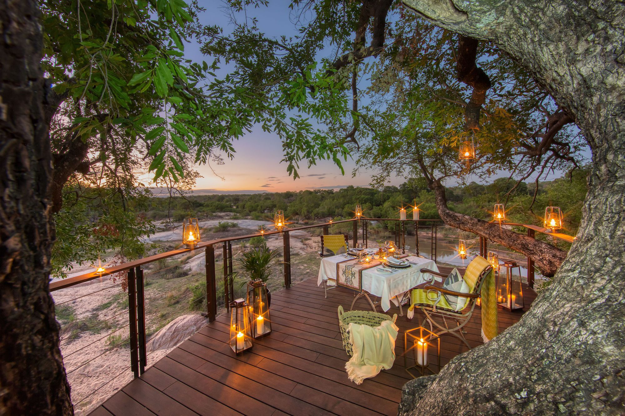 lookout deck with a table and chairs beneath lanterns on this Africa honeymoon safari
