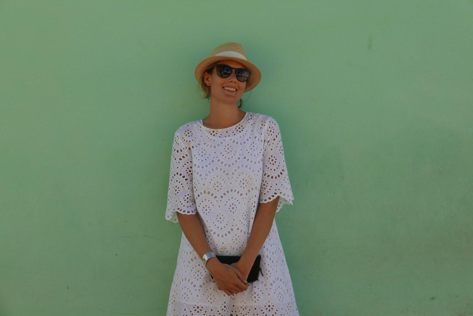 Elizabeth against green wall in Trinidad