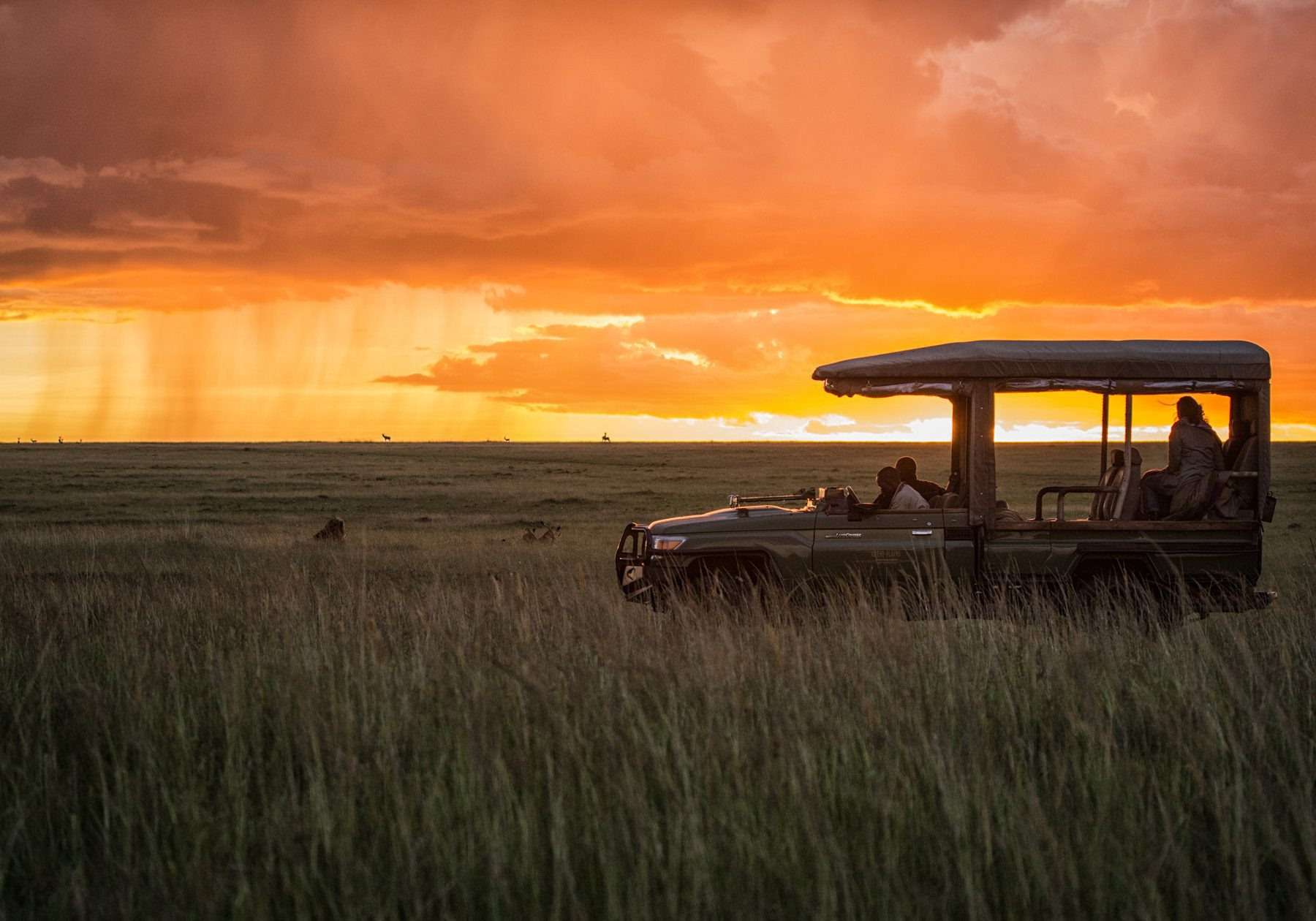 game vehicle on the open plains at sunset