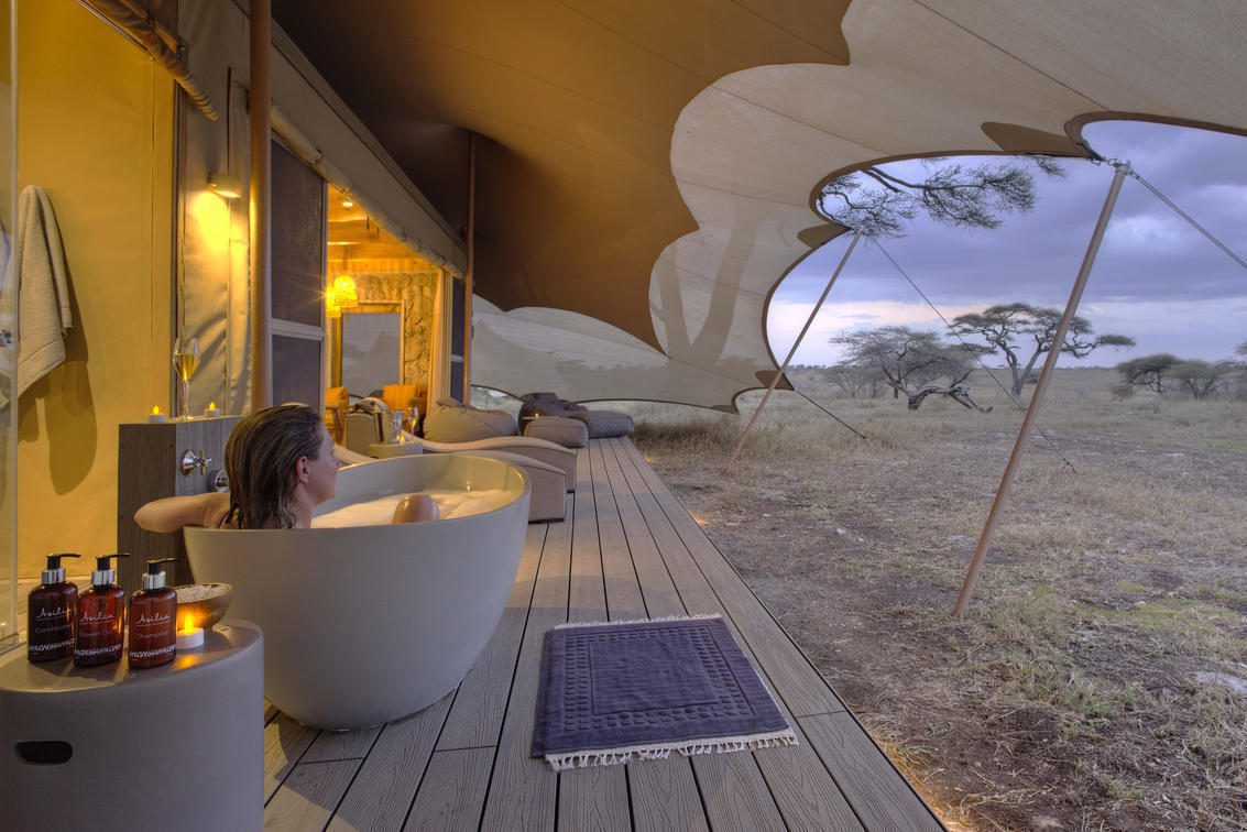 bathtub on the deck outside a tent at Namiri Plains on our Tanzania big game safari