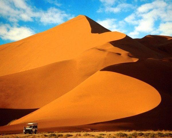 safari vehicle at base of dune 45 sossusvlei namibia