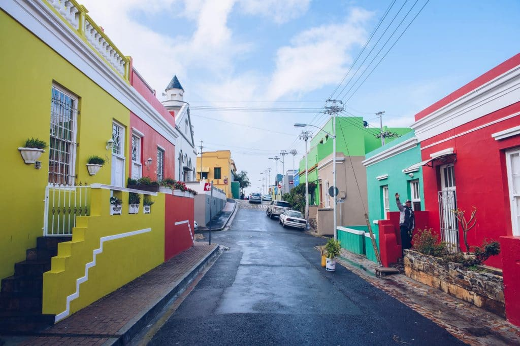 brightly painted houses line a street in cape town