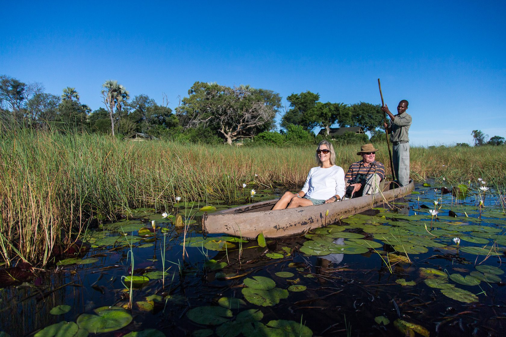 Seba Camp guests on a water safari with guide botswana on our off-grid Botswana safari