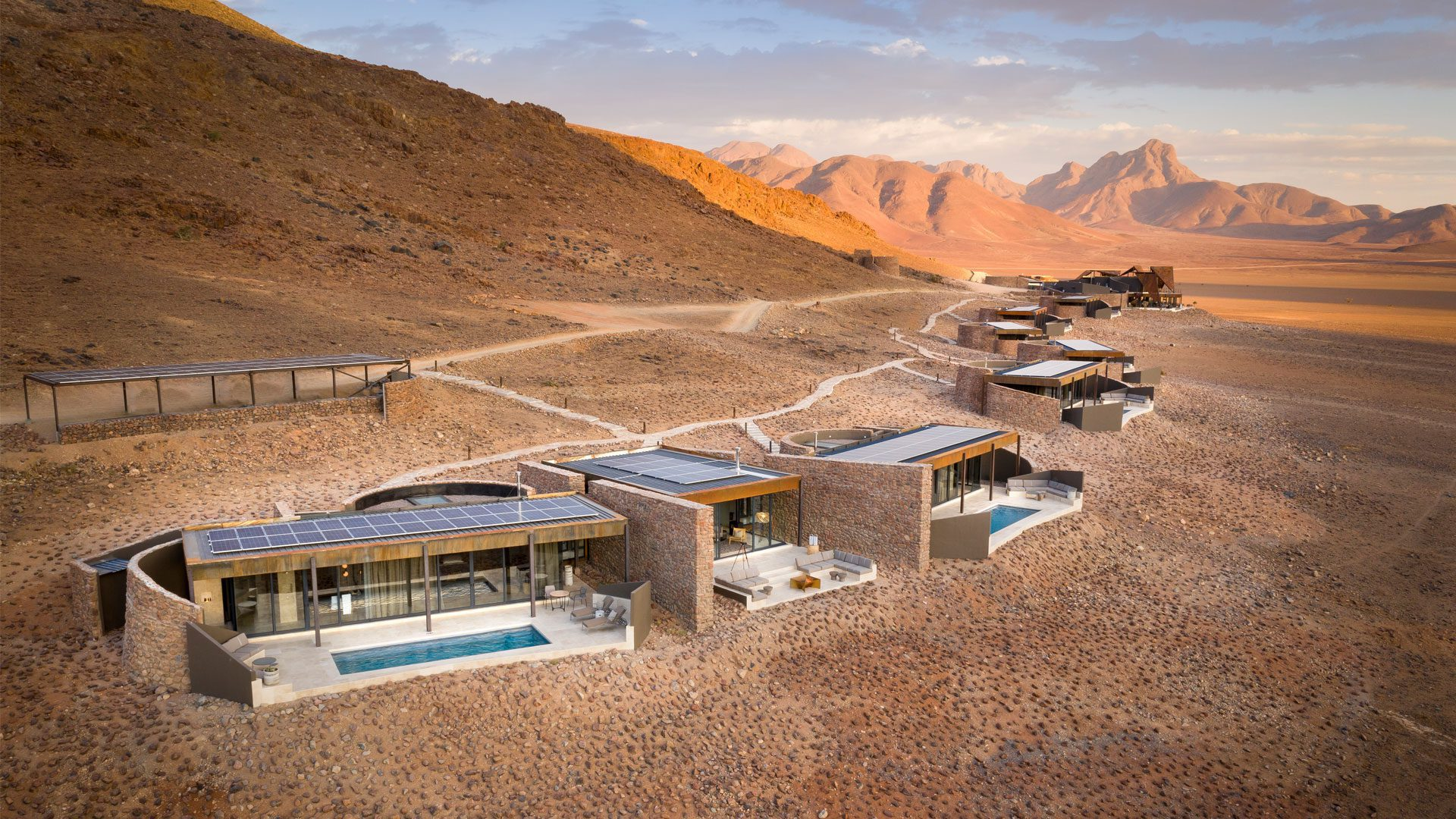 sprawling luxury lodge in the desert with swimming pools