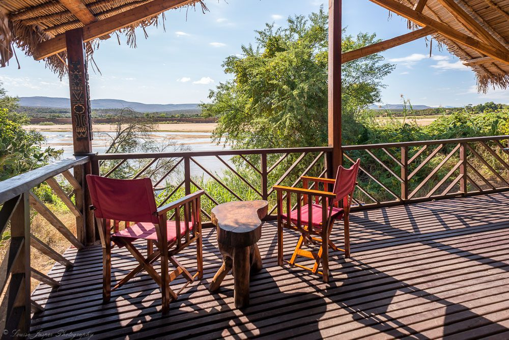 two chairs on a deck looking out to the river on our best Madagascar safari