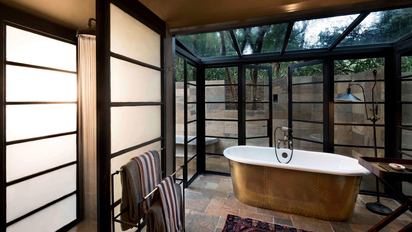 bath tub surrounded by glass doors on Southern Africa safari