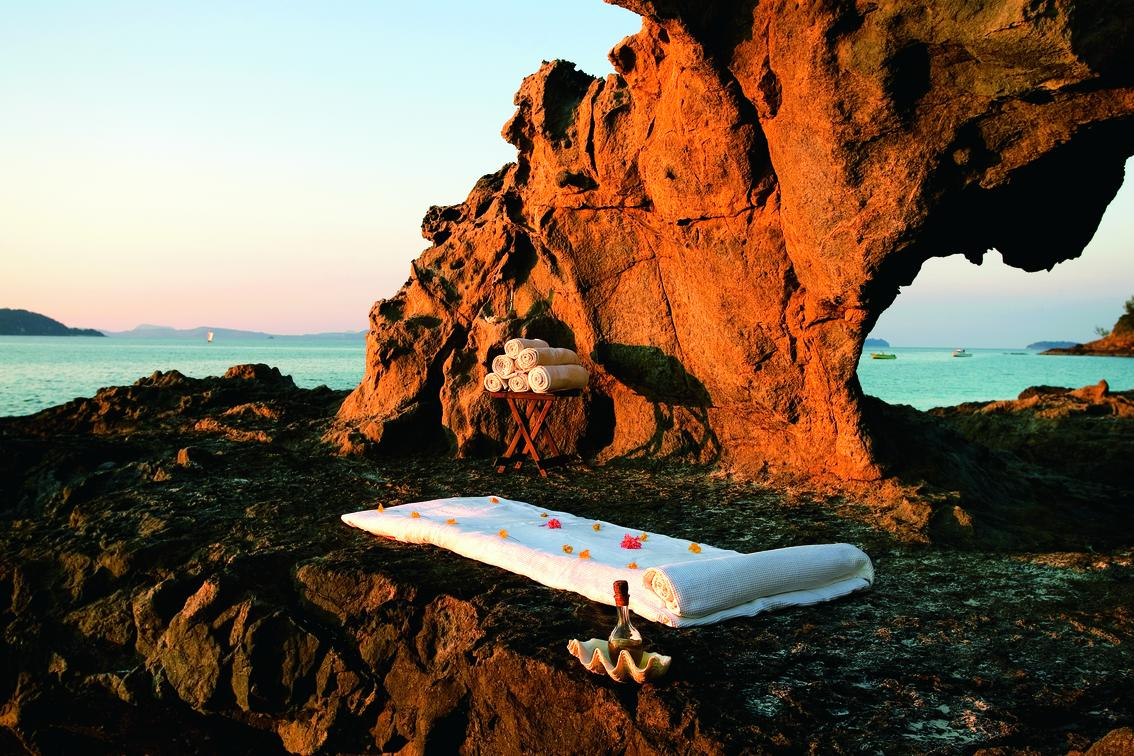 massage pad near rocks by the beach
