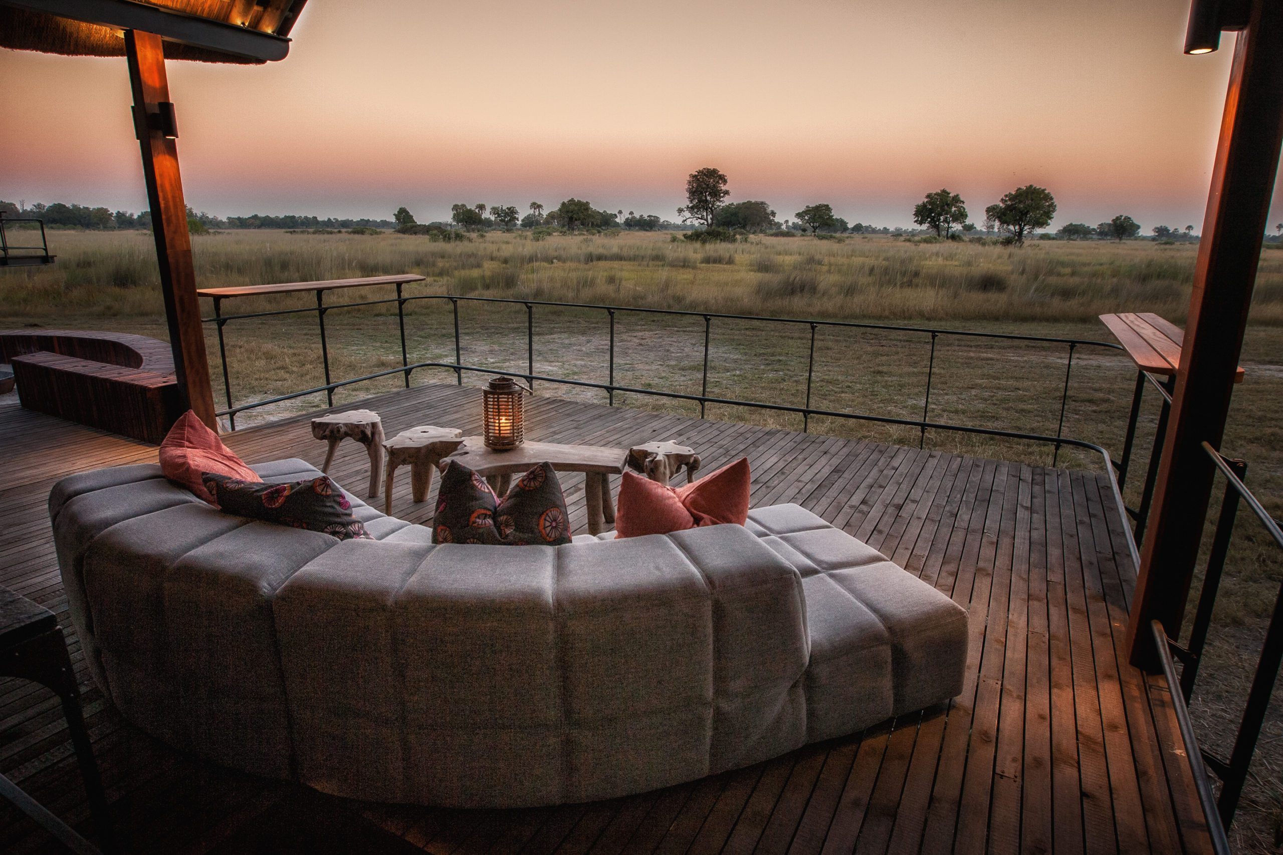 stay at Chitabe Camp deck lounge with view over the grassy plain on our off-grid Botswana safari