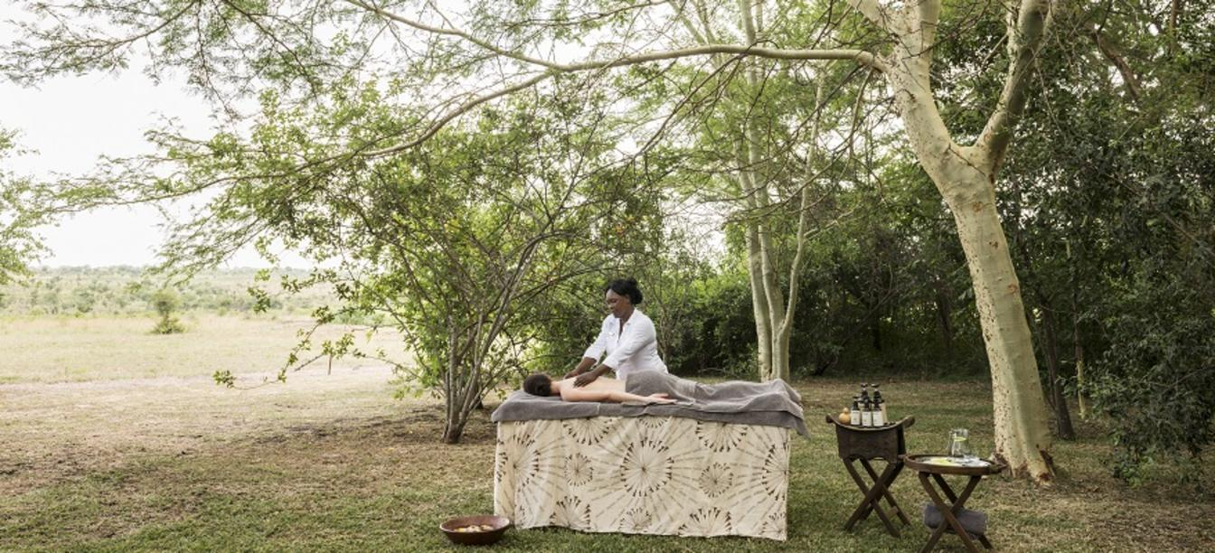 massage table in grassy area under trees