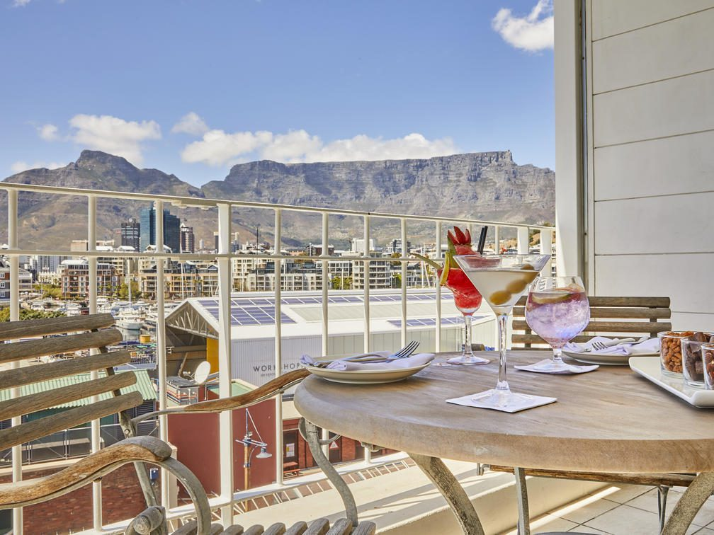 table and chair on balcony looking out to mountain and city on Southern Africa safari