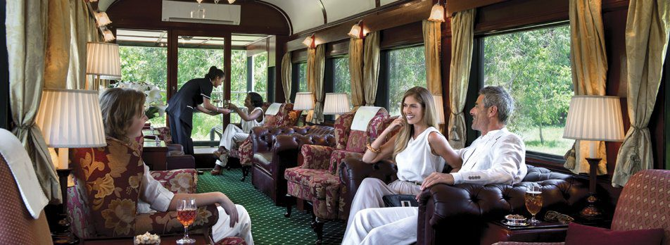 people in the lounge car on Rovos Rail on this Africa train safari
